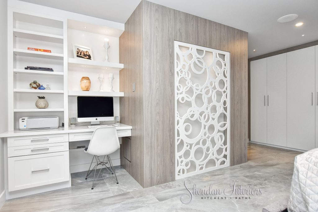 Contemporary Master Bedroom with dedicated computer station, laset cut focal point wall and wall to wall wardrobe, Sheridan Interiors