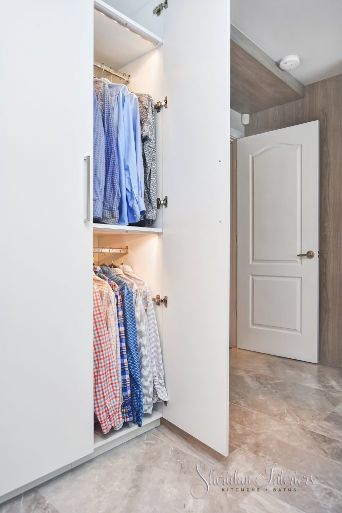 Contemporary reach in closet with full size doors, double hanging rods and interior lighting. Sheridan Interiors, cornwall, interior designer cornwall, interior designer ottawa